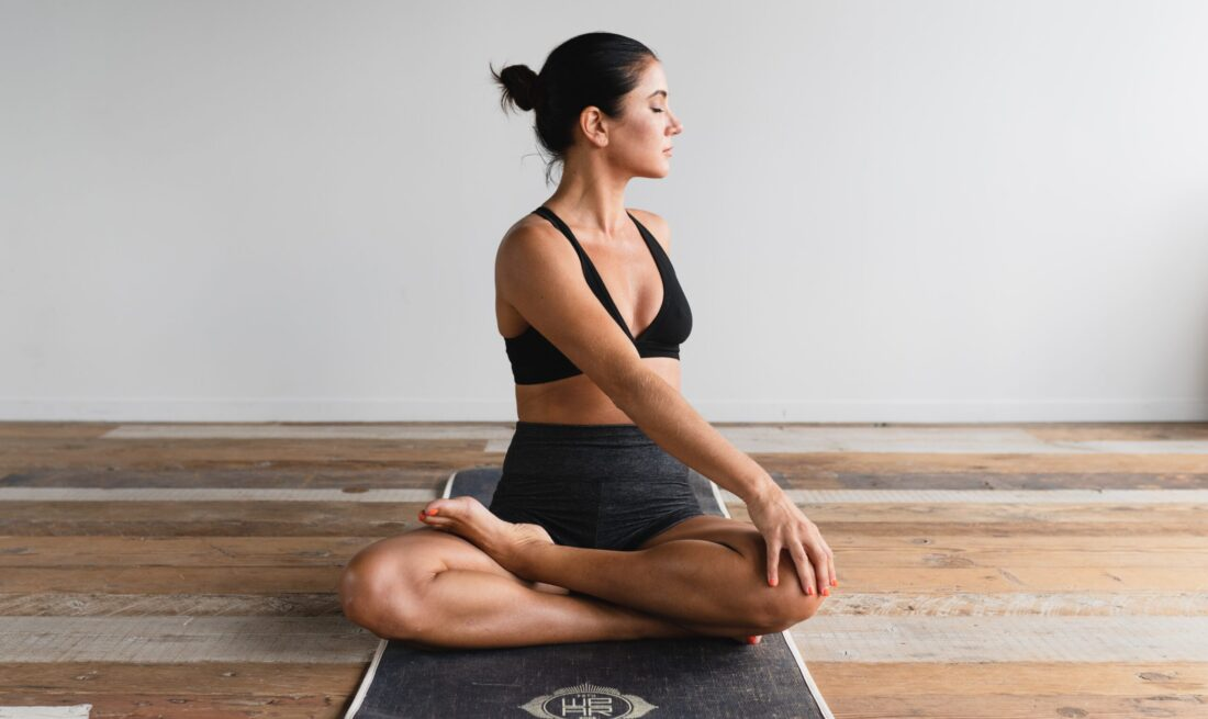 woman doing yoga and pilates